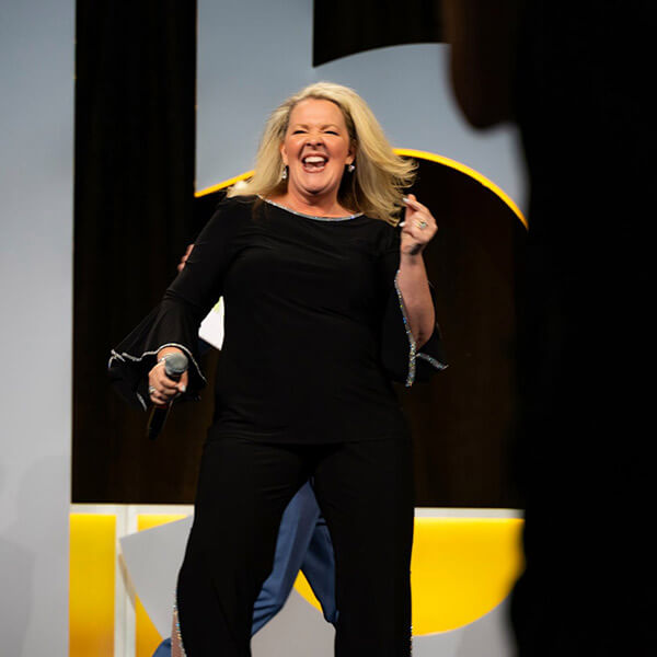 Lori Streeter dancing and laughing in the stage