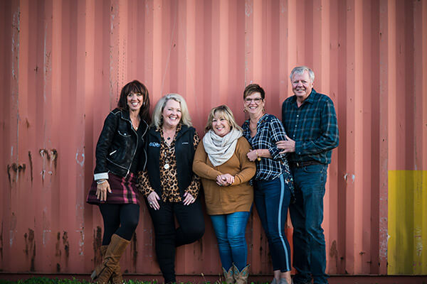 Lorie Streeter with four friends, three women and one man